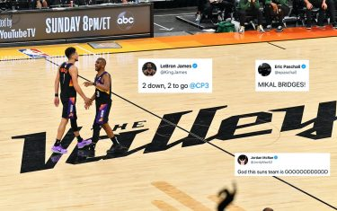 PHOENIX, AZ - JULY 8: Chris Paul #3 and Devin Booker #1 of the Phoenix Suns embrace during Game Two of the 2021 NBA Finals on July 8, 2021 at Phoenix Suns Arena in Phoenix, Arizona. NOTE TO USER: User expressly acknowledges and agrees that, by downloading and or using this photograph, user is consenting to the terms and conditions of the Getty Images License Agreement. Mandatory Copyright Notice: Copyright 2021 NBAE (Photo by Jesse D. Garrabrant/NBAE via Getty Images)