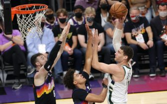 PHOENIX, AZ - JULY 8: Brook Lopez #11 of the Milwaukee Bucks shoots the ball against the Phoenix Suns during Game Two of the 2021 NBA Finals on July 8, 2021 at Phoenix Suns Arena in Phoenix, Arizona. NOTE TO USER: User expressly acknowledges and agrees that, by downloading and or using this photograph, user is consenting to the terms and conditions of the Getty Images License Agreement. Mandatory Copyright Notice: Copyright 2021 NBAE (Photo by Joe Murphy/NBAE via Getty Images)