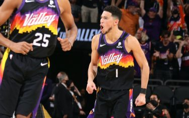 PHOENIX, AZ - July 8: Devin Booker #1 of the Phoenix Suns celebrates during Game Two of the 2021 NBA Finals on July 8, 2021 at Phoenix Suns Arena in Phoenix, Arizona. NOTE TO USER: User expressly acknowledges and agrees that, by downloading and or using this photograph, user is consenting to the terms and conditions of the Getty Images License Agreement. Mandatory Copyright Notice: Copyright 2021 NBAE (Photo by Nathaniel S. Butler/NBAE via Getty Images)