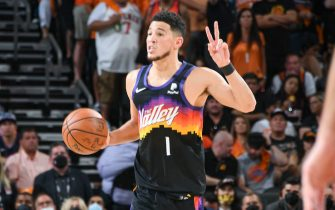 PHOENIX, AZ - JULY 8: Devin Booker #1 of the Phoenix Suns sets the play during the game against the Milwaukee Bucks during Game Two of the 2021 NBA Finals on July 8, 2021 at Phoenix Suns Arena in Phoenix, Arizona. NOTE TO USER: User expressly acknowledges and agrees that, by downloading and or using this photograph, user is consenting to the terms and conditions of the Getty Images License Agreement. Mandatory Copyright Notice: Copyright 2021 NBAE (Photo by Andrew D. Bernstein/NBAE via Getty Images)