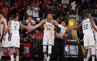 PHOENIX, AZ - July 8: Giannis Antetokounmpo #34 of the Milwaukee Bucks high fives Jeff Teague #5 of the Milwaukee Bucks and Khris Middleton #22 of the Milwaukee Bucks during Game Two of the 2021 NBA Finals on July 8, 2021 at Phoenix Suns Arena in Phoenix, Arizona. NOTE TO USER: User expressly acknowledges and agrees that, by downloading and or using this photograph, user is consenting to the terms and conditions of the Getty Images License Agreement. Mandatory Copyright Notice: Copyright 2021 NBAE (Photo by Nathaniel S. Butler/NBAE via Getty Images)