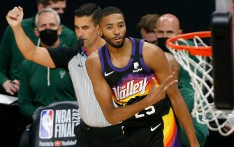 PHOENIX, ARIZONA - JULY 08: Mikal Bridges #25 of the Phoenix Suns celebrates a three point basket against the Milwaukee Bucks during the first half in Game Two of the NBA Finals at Phoenix Suns Arena on July 08, 2021 in Phoenix, Arizona. NOTE TO USER: User expressly acknowledges and agrees that, by downloading and or using this photograph, User is consenting to the terms and conditions of the Getty Images License Agreement. (Photo by Ralph Freso/Getty Images)