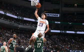 MILWAUKEE, WI - JULY 11: Cameron Johnson #23 of the Phoenix Suns dunks the ball against the Milwaukee Bucks during Game Three of the 2021 NBA Finals on July 11, 2021 at the Fiserv Forum Center in Milwaukee, Wisconsin. NOTE TO USER: User expressly acknowledges and agrees that, by downloading and or using this Photograph, user is consenting to the terms and conditions of the Getty Images License Agreement. Mandatory Copyright Notice: Copyright 2021 NBAE (Photo by Nathaniel S. Butler/NBAE via Getty Images).