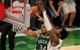 MILWAUKEE, WISCONSIN - JULY 11: Giannis Antetokounmpo #34 of the Milwaukee Bucks is fouled by Deandre Ayton #22 of the Phoenix Suns during the second half in Game Three of the NBA Finals at Fiserv Forum on July 11, 2021 in Milwaukee, Wisconsin. NOTE TO USER: User expressly acknowledges and agrees that, by downloading and or using this photograph, User is consenting to the terms and conditions of the Getty Images License Agreement. (Photo by Justin Casterline/Getty Images)