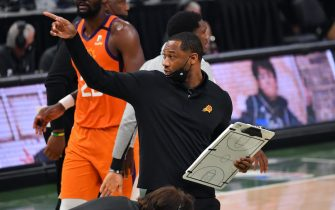 MILWAUKEE, WI - JULY 14: Assistant Coach Willie Green of the Phoenix Suns looks on during Game Four of the 2021 NBA Finals on July 14, 2021 at Fiserv Forum in Milwaukee, Wisconsin. NOTE TO USER: User expressly acknowledges and agrees that, by downloading and/or using this Photograph, user is consenting to the terms and conditions of the Getty Images License Agreement. Mandatory Copyright Notice: Copyright 2021 NBAE (Photo by Jesse D. Garrabrant/NBAE via Getty Images)