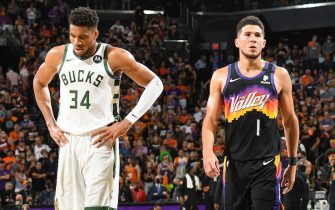 PHOENIX, AZ - JULY 17: Giannis Antetokounmpo #34 of the Milwaukee Bucks and Devin Booker #1 of the Phoenix Suns look on during Game Five of the 2021 NBA Finals on July 17, 2021 at Footprint Center in Phoenix, Arizona. NOTE TO USER: User expressly acknowledges and agrees that, by downloading and or using this photograph, user is consenting to the terms and conditions of the Getty Images License Agreement. Mandatory Copyright Notice: Copyright 2021 NBAE (Photo by Andrew D. Bernstein/NBAE via Getty Images)