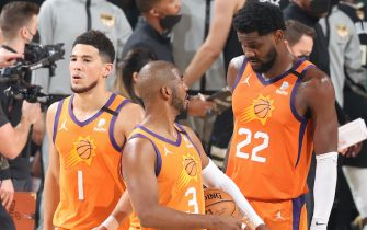 MILWAUKEE, WI - JULY 20: Chris Paul #3 talks with Devin Booker #1 and Deandre Ayton #22 of the Phoenix Suns during Game Six of the 2021 NBA Finals on July 20, 2021 at the Fiserv Forum in Milwaukee, Wisconsin. NOTE TO USER: User expressly acknowledges and agrees that, by downloading and or using this Photograph, user is consenting to the terms and conditions of the Getty Images License Agreement. Mandatory Copyright Notice: Copyright 2021 NBAE (Photo by David Sherman/NBAE via Getty Images).