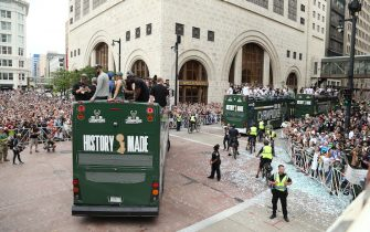 MILWAUKEE, WI - JULY 22:  Fans attend the Victory Parade & Rally of the 2021 NBA Finals on July 22, 2021 at the Fiserv Forum Center in Milwaukee, Wisconsin. NOTE TO USER: User expressly acknowledges and agrees that, by downloading and or using this Photograph, user is consenting to the terms and conditions of the Getty Images License Agreement. Mandatory Copyright Notice: Copyright 2021 NBAE (Photo by Gary Dineen/NBAE via Getty Images).