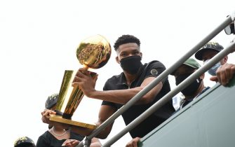 MILWAUKEE, WI - JULY 22: Giannis Antetokounmpo #34 of the Milwaukee Bucks holds the Larry O'Brien Trophy during their Victory Parade & Rally of the 2021 NBA Finals  on July 22, 2021 at the Fiserv Forum Center in Milwaukee, Wisconsin. NOTE TO USER: User expressly acknowledges and agrees that, by downloading and or using this Photograph, user is consenting to the terms and conditions of the Getty Images License Agreement. Mandatory Copyright Notice: Copyright 2021 NBAE (Photo by David Dow/NBAE via Getty Images).