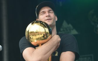 MILWAUKEE, WI - JULY 22: Brook Lopez #11 of the Milwaukee Bucks holds the Larry O'Brien Trophy during their Victory Parade & Rally of the 2021 NBA Finals  on July 22, 2021 at the Fiserv Forum Center in Milwaukee, Wisconsin. NOTE TO USER: User expressly acknowledges and agrees that, by downloading and or using this Photograph, user is consenting to the terms and conditions of the Getty Images License Agreement. Mandatory Copyright Notice: Copyright 2021 NBAE (Photo by David Dow/NBAE via Getty Images).