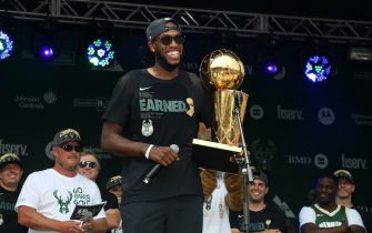 MILWAUKEE, WI - JULY 22: Khris Middleton #22 of the Milwaukee Bucks holds the Larry O'Brien Trophy during their Victory Parade & Rally of the 2021 NBA Finals on July 22, 2021 at the Fiserv Forum Center in Milwaukee, Wisconsin. NOTE TO USER: User expressly acknowledges and agrees that, by downloading and or using this Photograph, user is consenting to the terms and conditions of the Getty Images License Agreement. Mandatory Copyright Notice: Copyright 2021 NBAE (Photo by Gary Dineen/NBAE via Getty Images).