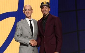 BROOKLYN, NY - JULY 29: Chris Duarte shakes hands with NBA Commissioner Adam Silver after being selected number thirteen overall by the Indiana Pacers during the 2021 NBA Draft on July 29, 2021 at Barclays Center in Brooklyn, New York. NOTE TO USER: User expressly acknowledges and agrees that, by downloading and or using this photograph, User is consenting to the terms and conditions of the Getty Images License Agreement. Mandatory Copyright Notice: Copyright 2021 NBAE (Photo by Brian Babineau/NBAE via Getty Images)