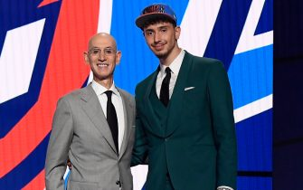 BROOKLYN, NY - JULY 29: Alperen Sengun shakes hands with NBA Commissioner Adam Silver after being selected number sixteen overall during the 2021 NBA Draft on July 29, 2021 at Barclays Center in Brooklyn, New York. NOTE TO USER: User expressly acknowledges and agrees that, by downloading and or using this photograph, User is consenting to the terms and conditions of the Getty Images License Agreement. Mandatory Copyright Notice: Copyright 2021 NBAE (Photo by Brian Babineau/NBAE via Getty Images)