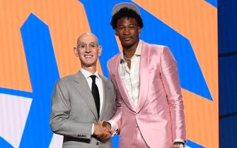 BROOKLYN, NY - JULY 29: Kai Jones shakes hands with NBA Commissioner Adam Silver after being selected number nineteen overall during the 2021 NBA Draft on July 29, 2021 at Barclays Center in Brooklyn, New York. NOTE TO USER: User expressly acknowledges and agrees that, by downloading and or using this photograph, User is consenting to the terms and conditions of the Getty Images License Agreement. Mandatory Copyright Notice: Copyright 2021 NBAE (Photo by Brian Babineau/NBAE via Getty Images)