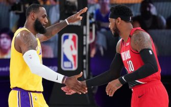 ORLANDO, FL - AUGUST 20: LeBron James #23 of the Los Angeles Lakers and Carmelo Anthony #00 of the Portland Trail Blazers high-five prior to a game during Round One, Game Two of the NBA Playoffs on August 20, 2020 at the AdventHealth Arena at ESPN Wide World Of Sports Complex in Orlando, Florida. NOTE TO USER: User expressly acknowledges and agrees that, by downloading and/or using this Photograph, user is consenting to the terms and conditions of the Getty Images License Agreement. Mandatory Copyright Notice: Copyright 2020 NBAE (Photo by Jesse D. Garrabrant/NBAE via Getty Images)
