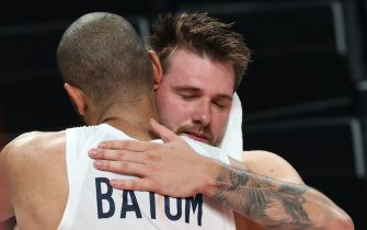 SAITAMA, JAPAN - AUGUST 05: Nicolas Batum #5 of Team France hugs Luka Doncic #77 of Team Slovenia following Team France victory over Team Slovenia in a Men's Basketball semi-finals game on day thirteen of the Tokyo 2020 Olympic Games at Saitama Super Arena on August 05, 2021 in Saitama, Japan. (Photo by Kevin C. Cox/Getty Images)
