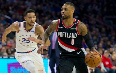 PHILADELPHIA, PA - FEBRUARY 23: Damian Lillard #0 of the Portland Trail Blazers dribbles the ball against Ben Simmons #25 of the Philadelphia 76ers in the first quarter at the Wells Fargo Center on February 23, 2019 in Philadelphia, Pennsylvania. NOTE TO USER: User expressly acknowledges and agrees that, by downloading and or using this photograph, User is consenting to the terms and conditions of the Getty Images License Agreement. (Photo by Mitchell Leff/Getty Images)