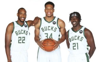 MILWAUKEE, WI - SEPTEMBER 27: Khris Middleton #22,  Giannis Antetokounmpo #34 and Jrue Holiday #21 of the Milwaukee Bucks poses for a portrait during NBA Media Day at Fiserv Forum on September 27, 2021 in Milwaukee, Wisconsin. NOTE TO USER: User expressly acknowledges and agrees that, by downloading and/or using this photograph, user is consenting to the terms and conditions of the Getty Images License Agreement.  Mandatory Copyright Notice: Copyright 2021 NBAE (Photo by Gary Dineen/NBAE via Getty Images)