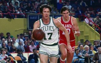 BOSTON - 1978:  John Havlicek #17 of the Boston Celtics moves the ball up court against Steve Hawes #10 of the Atlanta Hawks during a game played in 1978 at the Boston Garden in Boston, Massachusetts. NOTE TO USER: User expressly acknowledges and agrees that, by downloading and or using this photograph, User is consenting to the terms and conditions of the Getty Images License Agreement. Mandatory Copyright Notice: Copyright 1978 NBAE (Photo by Dick Raphael/NBAE via Getty Images)