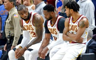 CLEVELAND, OH - OCTOBER 17, 2017: LeBron James #23, Dwyane Wade #9 and Derrick Rose #1 of the Cleveland Cavaliers sit on the scorers table during an injury timeout in the first half of a game against the Boston Celtics at Quicken Loans Arena on October 17, 2017 in Cleveland, Ohio. (Photo by: 2017 Nick Cammett/Diamond Images via Getty Images)