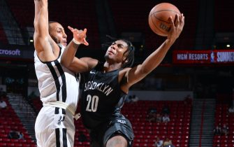 LAS VEGAS, NV - AUGUST 15: David Duke #20 of the Brooklyn Nets drives to the basket against the San Antonio Spurs during the 2021 Las Vegas Summer League on August 15, 2021 at the Thomas & Mack Center in Las Vegas, Nevada. NOTE TO USER: User expressly acknowledges and agrees that, by downloading and/or using this Photograph, user is consenting to the terms and conditions of the Getty Images License Agreement. Mandatory Copyright Notice: Copyright 2021 NBAE (Photo by Bart Young/NBAE via Getty Images)