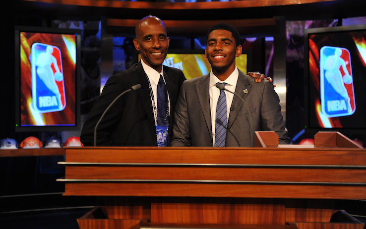 SECAUCUS, NJ - MAY 17:  Kyrie Irving, a 2011 NBA Draft prospect,  poses for a picture with his father Drederick prior to the 2011 NBA Draft Lottery at the Studios at NBA Entertainment on May 17, 2011 in Secaucus, New Jersey.  NOTE TO USER: User expressly acknowledges and agrees that, by downloading and/or using this Photograph, user is consenting to the terms and conditions of the Getty Images License Agreement. Mandatory Copyright Notice: Copyright 2011 NBAE (Photo by Jesse D. Garrabrant/NBAE via Getty Images)