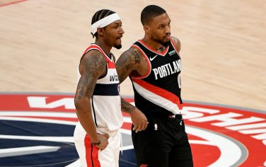 WASHINGTON, DC - FEBRUARY 02: Bradley Beal #3 of the Washington Wizards and Damian Lillard #0 of the Portland Trail Blazers look on during the first half at Capital One Arena on February 02, 2021 in Washington, DC. NOTE TO USER: User expressly acknowledges and agrees that, by downloading and or using this photograph, User is consenting to the terms and conditions of the Getty Images License Agreement. (Photo by Will Newton/Getty Images)