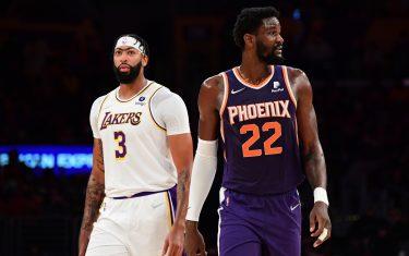 LOS ANGELES, CA - OCTOBER 10: Anthony Davis #3 of the Los Angeles Lakers and Deandre Ayton #22 of the Phoenix Suns look on during a preseason game on October 10, 2021 at STAPLES Center in Los Angeles, California. NOTE TO USER: User expressly acknowledges and agrees that, by downloading and/or using this Photograph, user is consenting to the terms and conditions of the Getty Images License Agreement. Mandatory Copyright Notice: Copyright 2021 NBAE (Photo by Adam Pantozzi/NBAE via Getty Images)