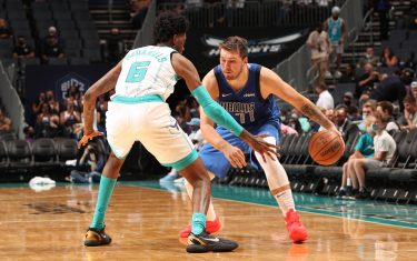 CHARLOTTE, NC - OCTOBER 13: Luka Doncic #77 of the Dallas Mavericks dribbles the ball during a preseason game against the Charlotte Hornets on October 13, 2021 at Spectrum Center in Charlotte, North Carolina. NOTE TO USER: User expressly acknowledges and agrees that, by downloading and or using this photograph, User is consenting to the terms and conditions of the Getty Images License Agreement. Mandatory Copyright Notice: Copyright 2021 NBAE (Photo by Kent Smith/NBAE via Getty Images)