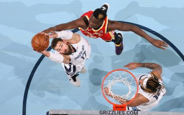MEMPHIS, TN - DECEMBER 17: Jonas Valanciunas #17 of the Memphis Grizzlies shoots the ball during a preseason game against Clint Capela #15 of the Atlanta Hawks on December 17, 2020 at FedExForum in Memphis, Tennessee. NOTE TO USER: User expressly acknowledges and agrees that, by downloading and or using this photograph, User is consenting to the terms and conditions of the Getty Images License Agreement. Mandatory Copyright Notice: Copyright 2020 NBAE (Photo by Joe Murphy/NBAE via Getty Images)