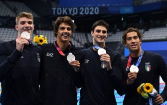 Silver medallists Italy's Alessandro Miressi, Italy's Thomas Ceccon, Italy's Lorenzo Zazzeri and Manuel Frigo pose with their medals after the final of the men's 4x100m freestyle relay swimming event during the Tokyo 2020 Olympic Games at the Tokyo Aquatics Centre in Tokyo on July 26, 2021. (Photo by Jonathan NACKSTRAND / AFP) (Photo by JONATHAN NACKSTRAND/AFP via Getty Images)