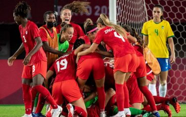 TOPSHOT - Canada's players celebrate winning the Tokyo 2020 Olympic Games women's quarter-final football match between Canada and Brazil at Miyagi Stadium in Miyagi on July 30, 2021. (Photo by Philip FONG / AFP) (Photo by PHILIP FONG/AFP via Getty Images)