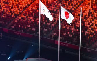 The Olympic and Japanese flags are pictured during the closing ceremony of the Tokyo 2020 Olympic Games, at the Olympic Stadium, in Tokyo, on August 8, 2021. (Photo by Antonin THUILLIER / AFP) (Photo by ANTONIN THUILLIER/AFP via Getty Images)
