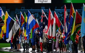 Athletes carrying nations' flags attend the closing ceremony of the Tokyo 2020 Olympic Games, at the Olympic Stadium, in Tokyo, on August 8, 2021. (Photo by Adek BERRY / AFP) (Photo by ADEK BERRY/AFP via Getty Images)