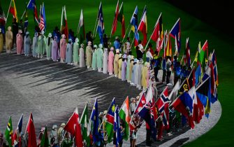 Athletes delegations arrive with their national flag during the closing ceremony of the Tokyo 2020 Olympic Games, at the Olympic Stadium, in Tokyo, on August 8, 2021. (Photo by Pedro PARDO / AFP) (Photo by PEDRO PARDO/AFP via Getty Images)