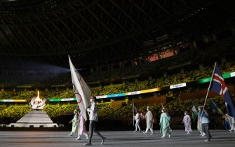 TOKYO, JAPAN - AUGUST 08: Flag bearer Hamoon Derafshipour of  Team Refugee Olympic team during the Closing Ceremony of the Tokyo 2020 Olympic Games at Olympic Stadium on August 08, 2021 in Tokyo, Japan. (Photo by Dan Mullan/Getty Images)