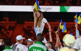 Ukraine's athletes gather on the field during the closing ceremony of the Tokyo 2020 Olympic Games, at the Olympic Stadium, in Tokyo, on August 8, 2021. (Photo by Adek BERRY / AFP) (Photo by ADEK BERRY/AFP via Getty Images)