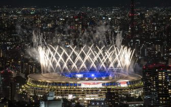 TOPSHOT - Fireworks light up the sky over the Olympic Stadium during the closing ceremony of the Tokyo 2020 Olympic Games, in Tokyo, on August 8, 2021. (Photo by Charly TRIBALLEAU / AFP) (Photo by CHARLY TRIBALLEAU/AFP via Getty Images)
