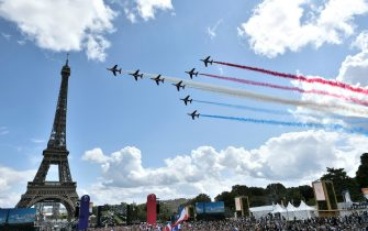 French aerial patrol fly over the fan village of The Trocadero set in front of The Eiffel Tower, in Paris on August 8, 2021 upon the transmission of the closing ceremony of the Tokyo 2020 Olympic Games. (Photo by STEPHANE DE SAKUTIN / AFP) (Photo by STEPHANE DE SAKUTIN/AFP via Getty Images)