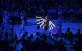 epa09427443 Artists perform during the opening ceremony of the Tokyo 2020 Paralympic Games in the Olympic Stadium in Tokyo, Japan, 24 August 2021.  EPA/Szilard Koszticsak HUNGARY OUT