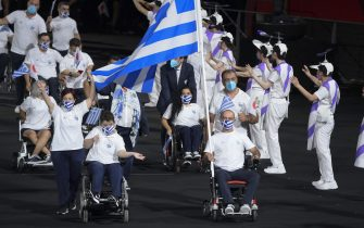 epa09427415 The team of Greece arrive during the opening ceremony of the Tokyo 2020 Paralympic Games in the Olympic Stadium in Tokyo, Japan, 24 August 2021.  EPA/Szilard Koszticsak HUNGARY OUT