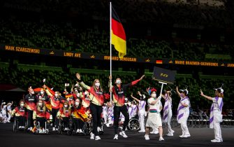 epa09427414 A handout photo made available by the Olympic Information Service (OIS) shows Members of the Germany Paralympic Team follow Athletes Mareike Miller (Wheelchair Basketball) and Michael Teuber (Cycling) as they parade into the Olympic Stadium during the Athletes' Parade at the Opening Ceremony for the Tokyo 2020 Paralympic Games, in Tokyo, Japan, 24 August 2021.  EPA/Joel Marklund for OIS HANDOUT  HANDOUT EDITORIAL USE ONLY/NO SALES