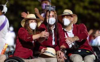 Handout photo dated 24/08/2021 provided by OIS of athletes from the Spain Paralympic Team stop for a selfie during the opening ceremony of the Tokyo 2020 Paralympic Games at Olympic Stadium in Japan. Picture date: Tuesday August 24, 2021.