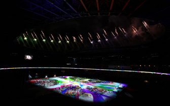 Teams from every country surround the stage as fireworks explode during the closing ceremony of the Tokyo 2020 Paralympic Games at Olympic Stadium in Japan. Picture date: Sunday September 5, 2021.