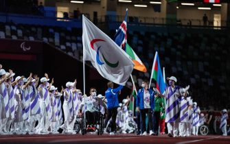 epa09449054 A handout photo made available by OIS/IOC shows Flag Bearer Anas Al Khalifa during the Closing Ceremony for the Tokyo 2020 Paralympic Games, Tokyo, Japan, Sunday 05 September 2021.  EPA/Thomas Lovelock for OIS HANDOUT   EDITORIAL USE ONLY/NO SALES