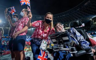 epa09449055 A handout photo made available by OIS/IOC shows members of the Great Britain team enjoying themselves in the Olympic Stadium during the Closing Ceremony for the Tokyo 2020 Paralympic Games, Tokyo, Japan, Sunday 05 September 2021.  EPA/Thomas Lovelock for OIS HANDOUT   EDITORIAL USE ONLY/NO SALES
