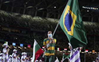 epa09449057 A handout photo made available by OIS/IOC shows Flag Bearer DanielDias of Brazil carrying his national flag into the Olympic Stadium during the Closing Ceremony for the Tokyo 2020 Paralympic Games, Tokyo, Japan, Sunday 05 September 2021.  EPA/Thomas Lovelock for OIS HANDOUT   EDITORIAL USE ONLY/NO SALES