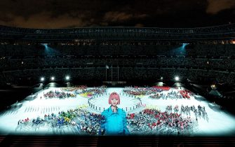 epa09448880 A handout photo made available by OIS/IOC shows fireworks going off around the rim of the Stadium as athletes watch from seats on the Field of Play whilst performers and a light show entertain them in the This is Tokyo segment of Closing Ceremony for the Tokyo 2020 Paralympic Games, Tokyo, Japan, 05 September 2021.  EPA/Joe Toth for OIS HANDOUT   EDITORIAL USE ONLY/NO SALES