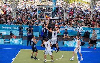 epa07076968 A handout photo made available by the OIS/IOC of Juan Esteban De La Fuente (top) of Argentina putting the ball into the basket during the Basketball 3x3 Men's Preliminary Round match between Argentina and Estonia at the Youth Olympic Games, Buenos Aires, Argentina, 07 October 2018.  EPA/Simon Bruty for OIS/IOC  HANDOUT EDITORIAL USE ONLY