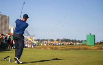 epa05481277 Henrik Stenson of Sweden hits from the seventeenth tee during the third round of the Rio 2016 Olympic Games men's golf tournament at the Olympic Golf Course in Barra da Tijuca, Rio de Janeiro, Brazil, 13 August 2016.  EPA/ERIK S. LESSER